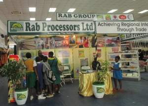 Primary school students admiring products for a company that has completed its investment intentions under the New Alliance