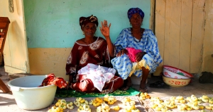 Women selling their produce at a local market in the URR.